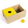 Pudełko z żółtą pokrywką i piłeczką
